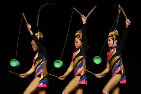 Pomona, California, USA - September 15, 2014: Chinese acrobats are performing acrobatics at LA County Fair in Pomona, California.
