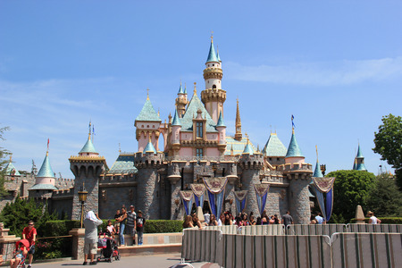 disneyland: Anaheim, California, USA - May 30, 2014: Sleeping Beauty Castle, the fairy tale structure castle at Disneyland, is based on the late 19th century Neuschwanstein Castle in Bavaria, Germany with some French inspiration. Tourists are able to walk through the
