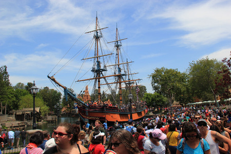 Anaheim, California, USA - May 30, 2014: The Sailing Ship Columbia is sailing in Rivers of America at Frontierland, which is home to the Pinewood Indians Band of Animatronic Native Americans who live on the banks of the Rivers of America at Disneyland.