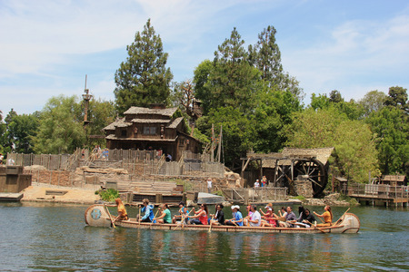 Anaheim, California, USA - May 30, 2014: Scenery of Frontierland, which is home to the Pinewood Indians Band of Animatronic Native Americans who live on the banks of the Rivers of America, at Disneyland.