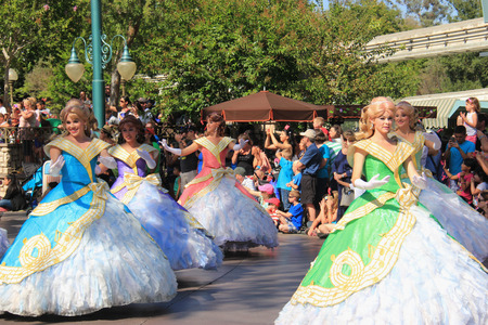 Anaheim, California, USA - May 30, 2014: Performers in Beautiful Princess Dresses in Disney Parade at Disneyland, California