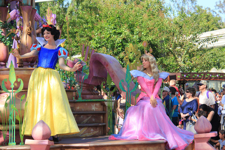 Anaheim, California, USA - May 30, 2014: Snow White and Princess Aurora in Disney Parade at Disneyland, California