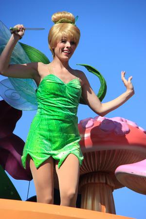 Anaheim, California, USA - May 30, 2014: Tinker Bell from Peter Pan in Disney Parade at Disneyland Editorial