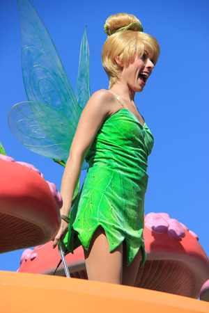 tinker bell: Anaheim, California, USA - May 30, 2014: Tinker Bell from Peter Pan in Disney Parade at Disneyland Editorial