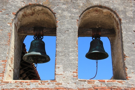 toppled: Bells at the bell tower in Mission San Juan Capistrano was erected a year after the bell tower at the Great Stone Church was toppled in the 1812 earthquake. Stock Photo
