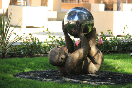 Statue of Monkey Playing a Ball at Beautiful Decorated Park