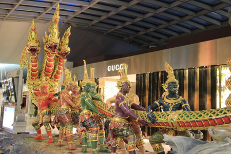 Bangkok, Thailand - December 29, 2013: Sculpture of Churning of the Ocean of Milk is the main decoration at Departure Area at Suwanabhumi Airport, the main airport of Bangkok, Thailand