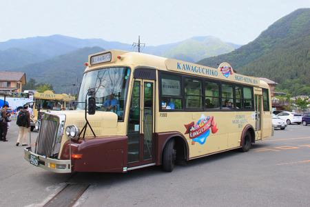 retro: Kawaguchiko, Japan - May 26, 2013: Kawaguchiko Sightseeing Retro Bus serves the path around the Kawaguchi Lake, stopping at many local tourist attractions.
