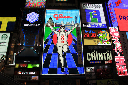 Osaka, Japan - May 26, 2013: Glico billboard displaying the image of a runner crossing a finishing line, is an icon of Osaka, Japan. It is located in Dotonbori, a famous tourist destination for nightlife and entertainment area.