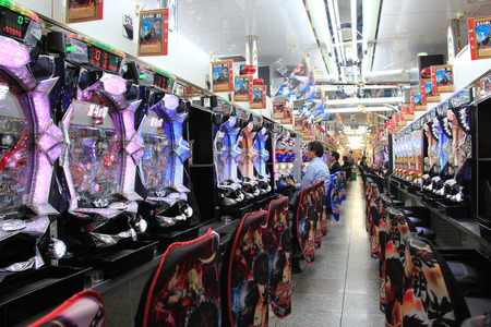 Osaka, Japan - May 27, 2013: Parlor of Pachinko, a type of mechanical game originating in Japan, is used as a recreational arcade game and gambling device. Zdjęcie Seryjne - 37182185