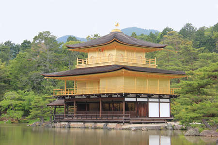 rokuonji: Kyoto, Japan - May 27, 2013: Temple of the Golden Pavilion or Kinkaku-ji or Rokuon-ji, a famous Zen Buddhist Temple, is a National Special Historic Site in Kyoto, Japan.