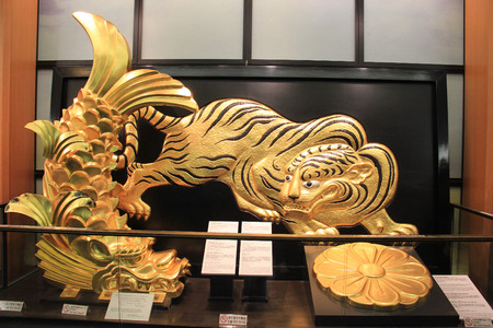 presti: Osaka, Japan - May 28, 2013: Golden Tiger and Shachihoko, signs of the prestige and authority of the castle lord and were thought to protect the castle from fire, inside Osaka Castle
