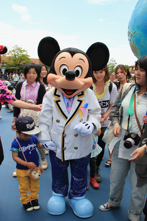 Tokyo, Japan - May 29, 2013: Mickey Mouse, the official mascot of the Walt Disney Company, is greeting tourists at Tokyo DisneySea.