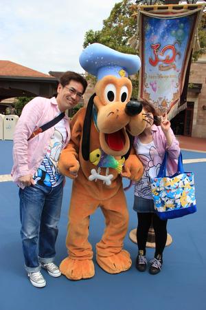 mickey: Tokyo, Japan - May 29, 2013: Pluto, Mickey Mouse\ Editorial