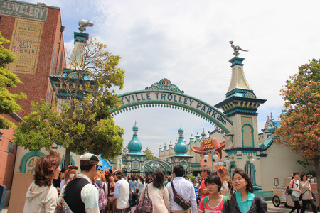 theme parks: Tokyo, Japan - May 29, 2013: Toy Ville Trolley Park, inspired by the famous victorian Coney Island style, is a new area at the American Waterfront, Tokyo DisneySea. It has a unique style that people have never seen in any other Disney theme parks.