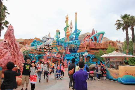 Tokyo, Japan - May 29, 2013: Scenery of Mermaid Lagoon, made to look like the Palace of King Triton and featured fanciful seashell-inspired architecture, provides rides towards younger children at Tokyo DisneySea.