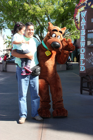 theme parks: Los Angeles, California, USA - March 12, 2015: The character Scooby from Scooby-Doo movie is greeting tourists at Universal Studios Hollywood, which is the first film studio and theme park of Universal Studios Theme Parks across the world.