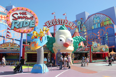 Los Angeles, California, USA - March 12, 2015: The Simpsons Ride, located on upper lot of Universal Studios Hollywood, is a family friendly simulator adventure through Springfield. Sajtókép