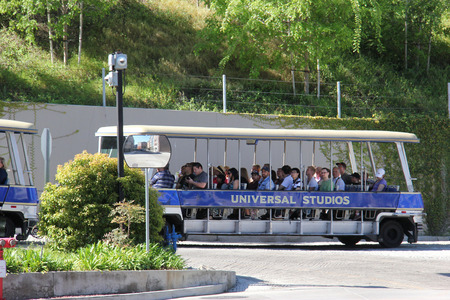 Los Angeles, California, USA - March 12, 2015: Studio Tour Tram is taking tourists to visit the studios used in many Hollywood movies at Universal Studios Hollywood, which is the first film studio and theme park of Universal Studios Theme Parks across the