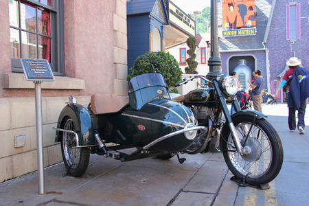 enfield: Los Angeles, California, USA - March 12, 2015: The 1939 Royal Enfield Bullet 500cc, the actual motorbike from The Mummy Returns 2001, is displayed at Universal Studios Hollywood.