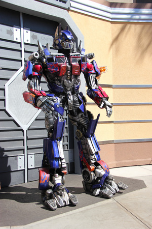 hollywood movie: Los Angeles, California, USA - March 12, 2015: The Impersonator of Transformers movie is welcoming tourists in front of the Transformers Ride at Universal Studios Hollywood.