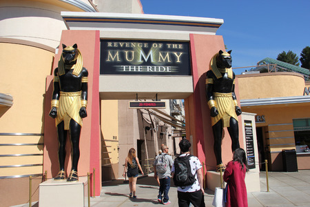 12 hour: Los Angeles, California, USA - March 12, 2015: Revenge of the Mummy is a 2 minute indoor steel roller on very agressive drops, climbs and turns with speeds up to 45 miles per hour.