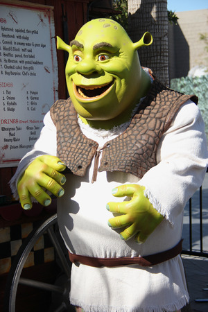 Los Angeles, California, USA - March 12, 2015: The movie character Shrek is taking photos with tourists at Universal Studios Hollywood, which is the first film studio and theme park of Universal Studios Theme Parks across the world.