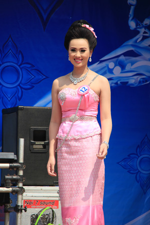 contestant: Chiangrai, Thailand - April 13, 2014: Unidentified contestant for Miss Songkran 2014 is walking on the stage for judges to consider. Editorial