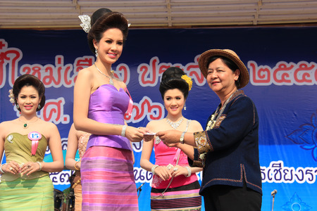 beauty contest: Chiangrai, Thailand - April 13, 2014: The fourth runner-up is receiving award for Miss Songkran Beauty Contest 2014.