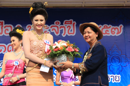 beauty contest: Chiangrai, Thailand - April 13, 2014: The second runner-up is receiving award for Miss Songkran Beauty Contest 2014. Editorial