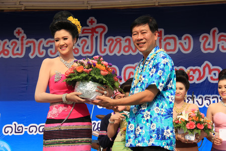 beauty contest: Chiangrai, Thailand - April 13, 2014: The first runner-up is receiving award for Miss Songkran Beauty Contest 2014. Editorial