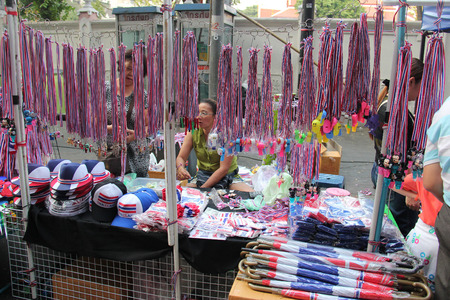 shutdown: Bangkok, Thailand - January 26, 2014: Many products with Thailand Flag colors and protester