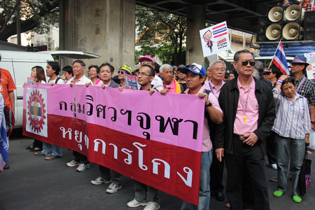 civil disorder: Bangkok, Thailand - January 1, 2014: White Collar Group gather together to protest against the government and promote campaign of reforming the country before election.