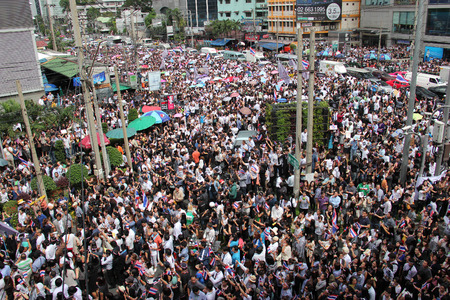 Bangkok, Thailand - November 7, 2013: Protestors hold an anti-government rally and gather together at Asok Intersection to blow whistles to make symbolic protest against the amnesty bill. Editorial