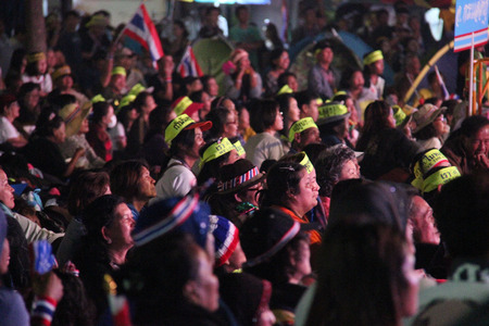 Bangkok, Thailand - January 26, 2014: Many people are listening to speech of Suthep Thaugsuban, a Thai politician and the most prominent leader of the anti-government protests that started in late October 2013, in front of MBK Center, the main protesting  Editorial
