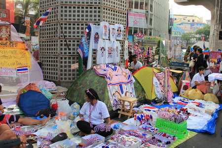 Bangkok, Thailand - January 26, 2014: Many products with Thailand Flag colors and protester