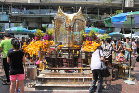 Bangkok Thailand  April 16 2015: People are paying respect to the Erawan Shrine which is a Hindu shrine housing a statue of Phra Phrom the Thai representation of the Hindu creation God Brahma.