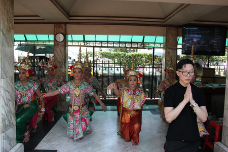 phrom: Bangkok Thailand  April 16 2015: Thai dance troupes hired by worshipers perform Thai dance to pay respect to the Erawan Shrine which is a Hindu shrine housing a statue of Phra Phrom the Thai representation of the Hindu creation God Brahma. Editorial