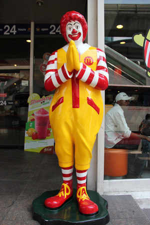 mcdonald: Bangkok Thailand  April 16 2015: Ronald McDonald statue is greeting customers with the traditional Thai Wai gesture in Bangkok Thailand. Editorial