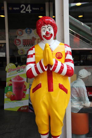 Bangkok Thailand  April 16 2015: Ronald McDonald statue is greeting customers with the traditional Thai Wai gesture in Bangkok Thailand. Editorial