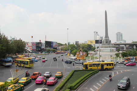 trammel: Bangkok Thailand  April 16 2015: Victory Monument one of Bangkoks major traffic intersections is a large military monument erected in June 1941 to commemorate the Thai victory in the FrancoThai War.