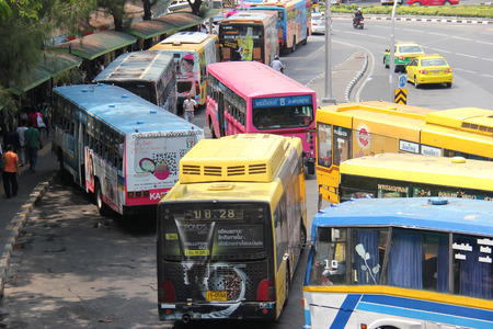 Bangkok Thailand  April 16 2015: Many Bangkok BMTA bus lines stop around the Victory Monuments traffic circle which is one of Bangkoks major traffic intersections.