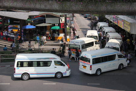 Bangkok Thailand  April 16 2015: Many private commuter van lines use the Victory Monuments traffic circle which is one of Bangkoks major traffic intersections as a terminus.