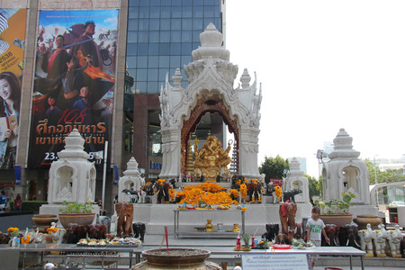 trimurti: Bangkok Thailand  April 16 2015: The Ganesha Shrine located in front of Central World is the god of accomplishment wisdom and wealth the destroyer of evil and obstacles. Editorial