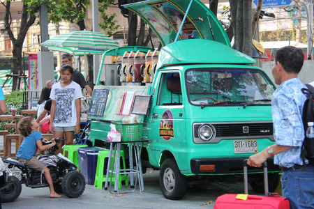 Bangkok Thailand April 16 2015: Tourists are buying juices from a food truck parking near Platinum Fashion Mall.