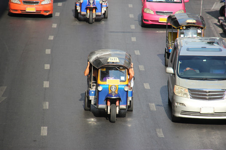 The auto rickshaw known as tuktuk is a widely used form of urban transportation in Bangkok and other Thai cities. It is one of symbols of Thailand. photo
