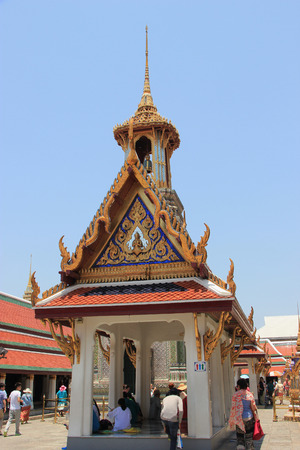 potent: Bangkok Thailand  April 21 2015: Emerald Buddha Temple is the most sacred Buddhist temple a potent religionpolitical symbol and the palladium of Thai society. Editorial