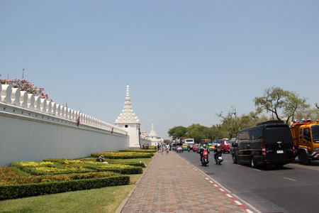Bangkok Thailand  April 21 2015: Na Phra Lan Road in front of Emerald Buddha Temple which is the most sacred Buddhist temple a potent religionpolitical symbol and the palladium of Thai society.