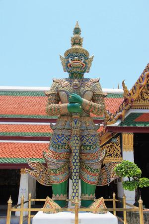 hugh: Guardian protecting Emerald Buddha Temple in Bangkok Thailand Stock Photo