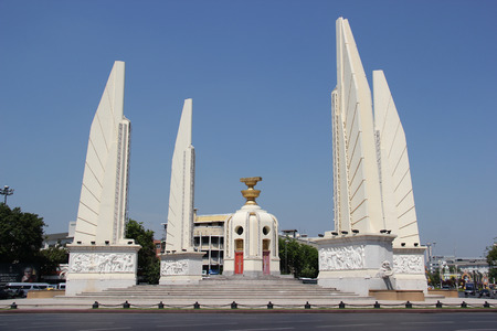 democracy Monument: Bangkok Thailand  April 21 2015: The Democracy Monument is a public monument commemorating the 1932 Siamese Revolution which lead to the establishment of a constitutional monarchy in Thailand. Editorial